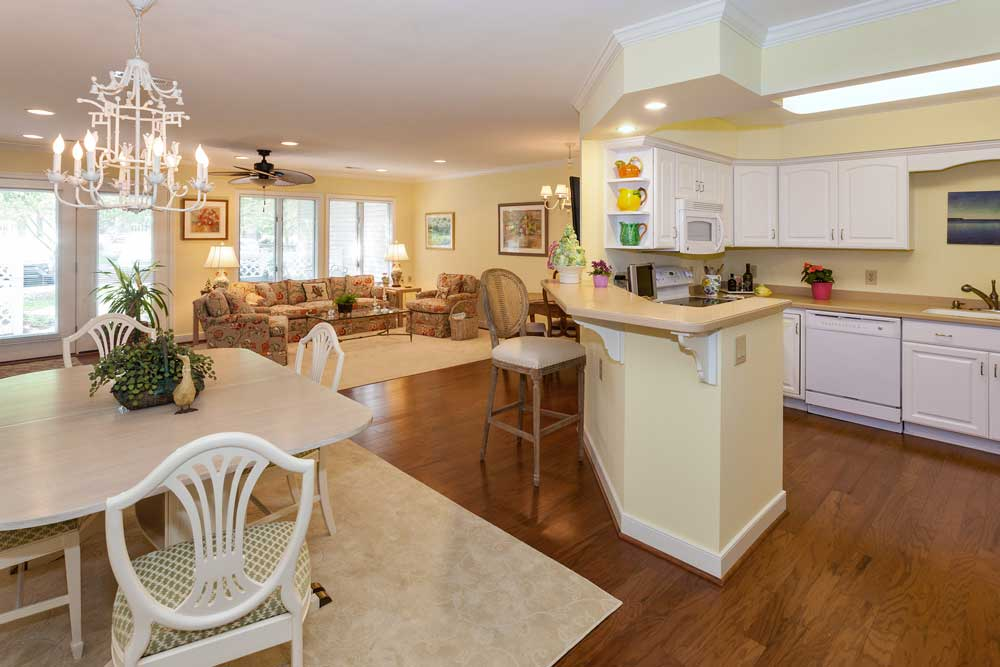 An interior view of a cottage kitchen and great room