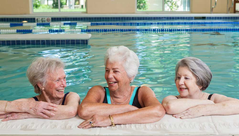 Three ladies enjoy a relaxing dip in our swimming pool