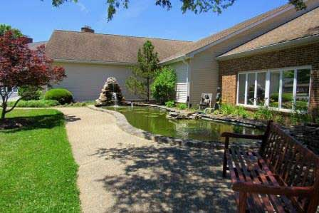 walkway-pond-behind-cottages