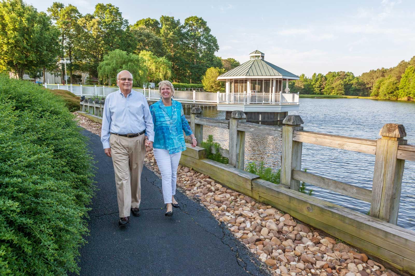 couple-walking-lakefront
