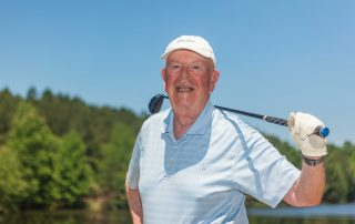 A man pauses while enjoying a round of golf