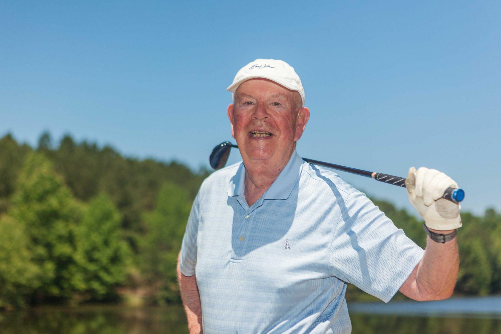 man-enjoys-golfing