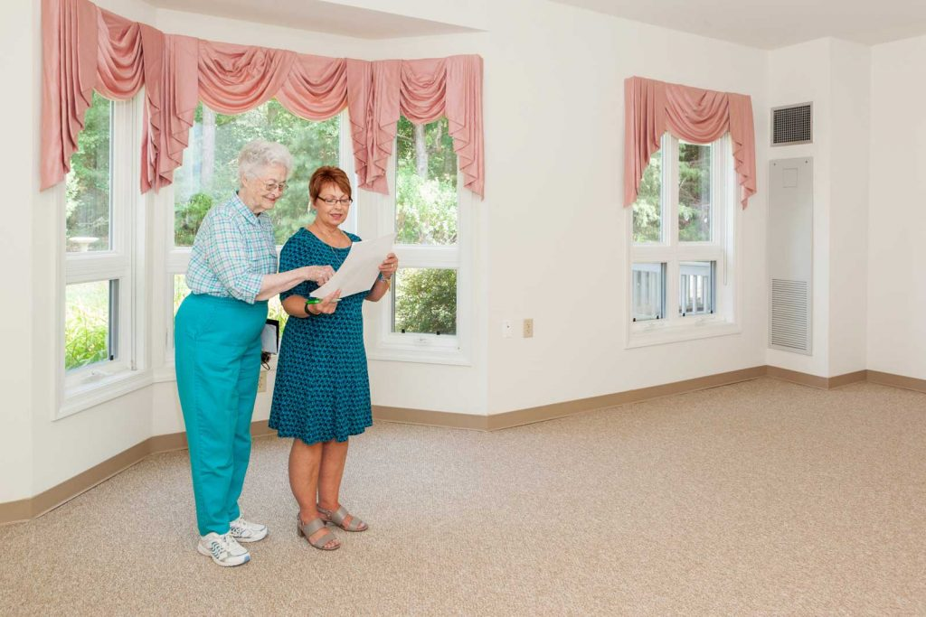 One of our staff shows an apartment to a prospective resident