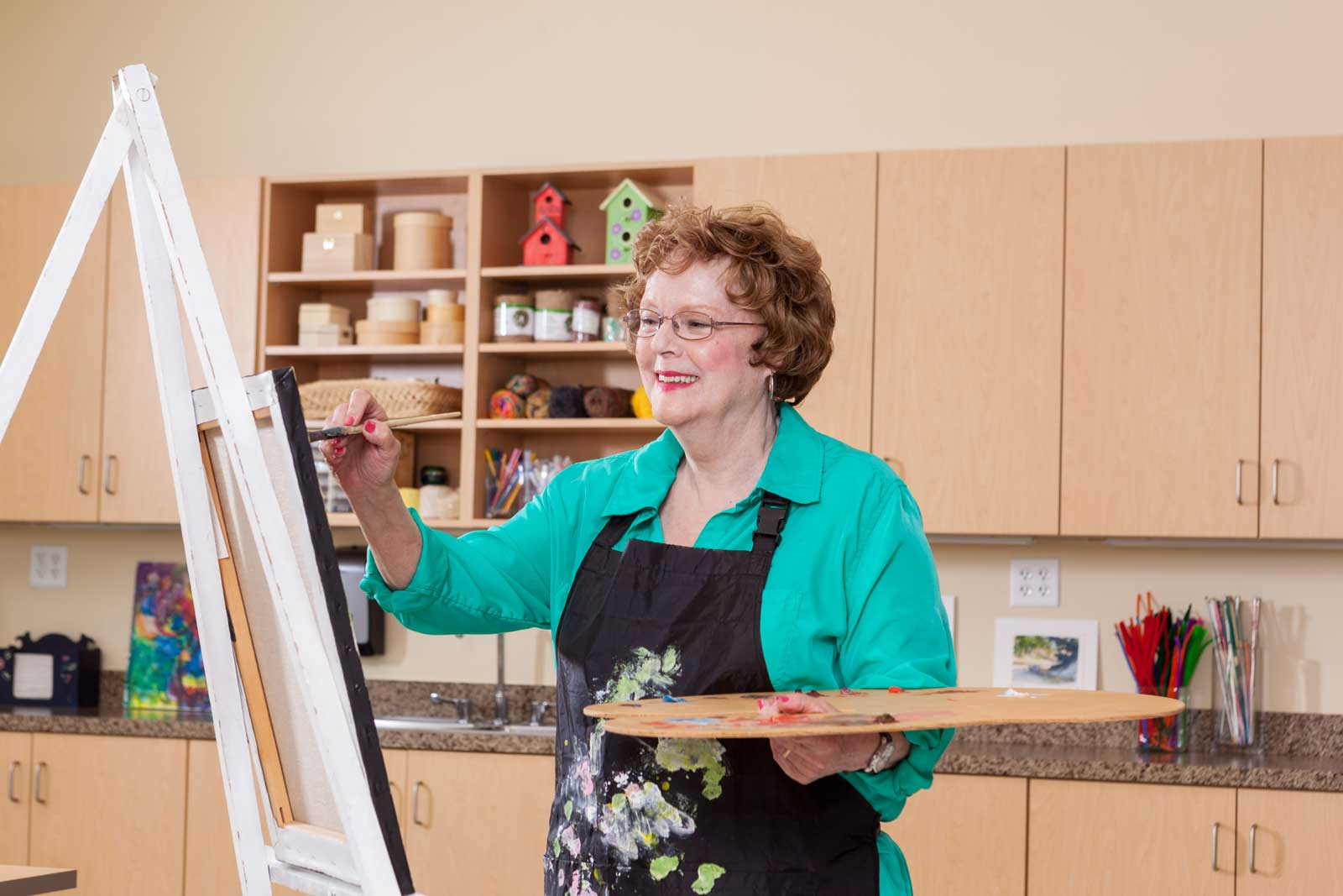 woman-enjoys-painting