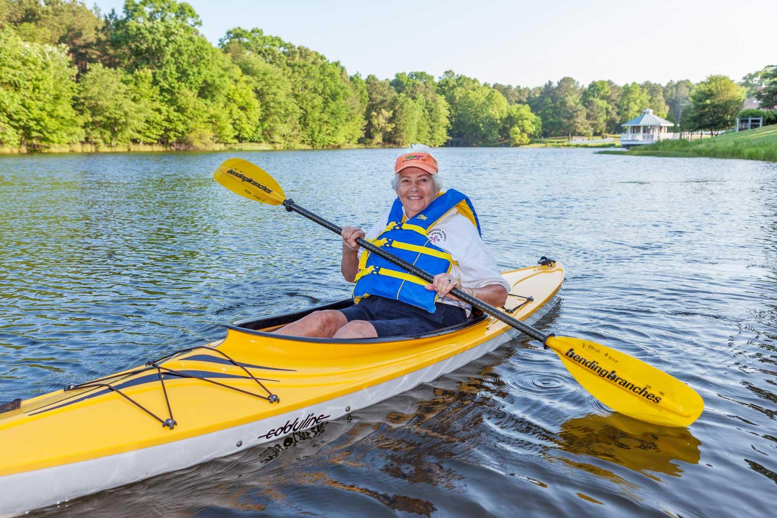 woman-kayaking-lake