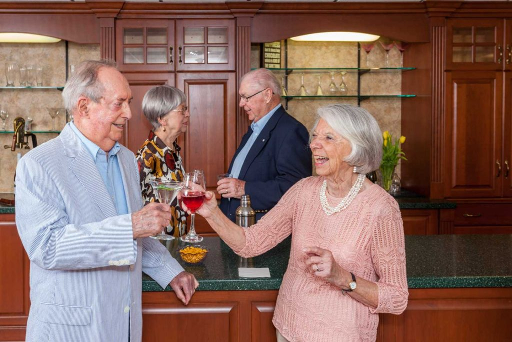 Two couples enjoy drinks at The Pub