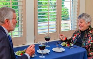 A couple enjoys wine and a salad before their meal